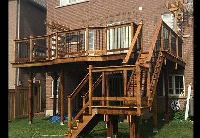 Completed pressure treated deck with aluminum balusters in Aurora